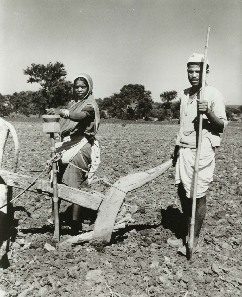 Indian farm family with plough and seeder